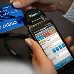 A UMS Funds merchant services client uses one of our mobile credit card processing terminals.